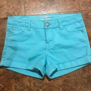 Light blue shorts.
